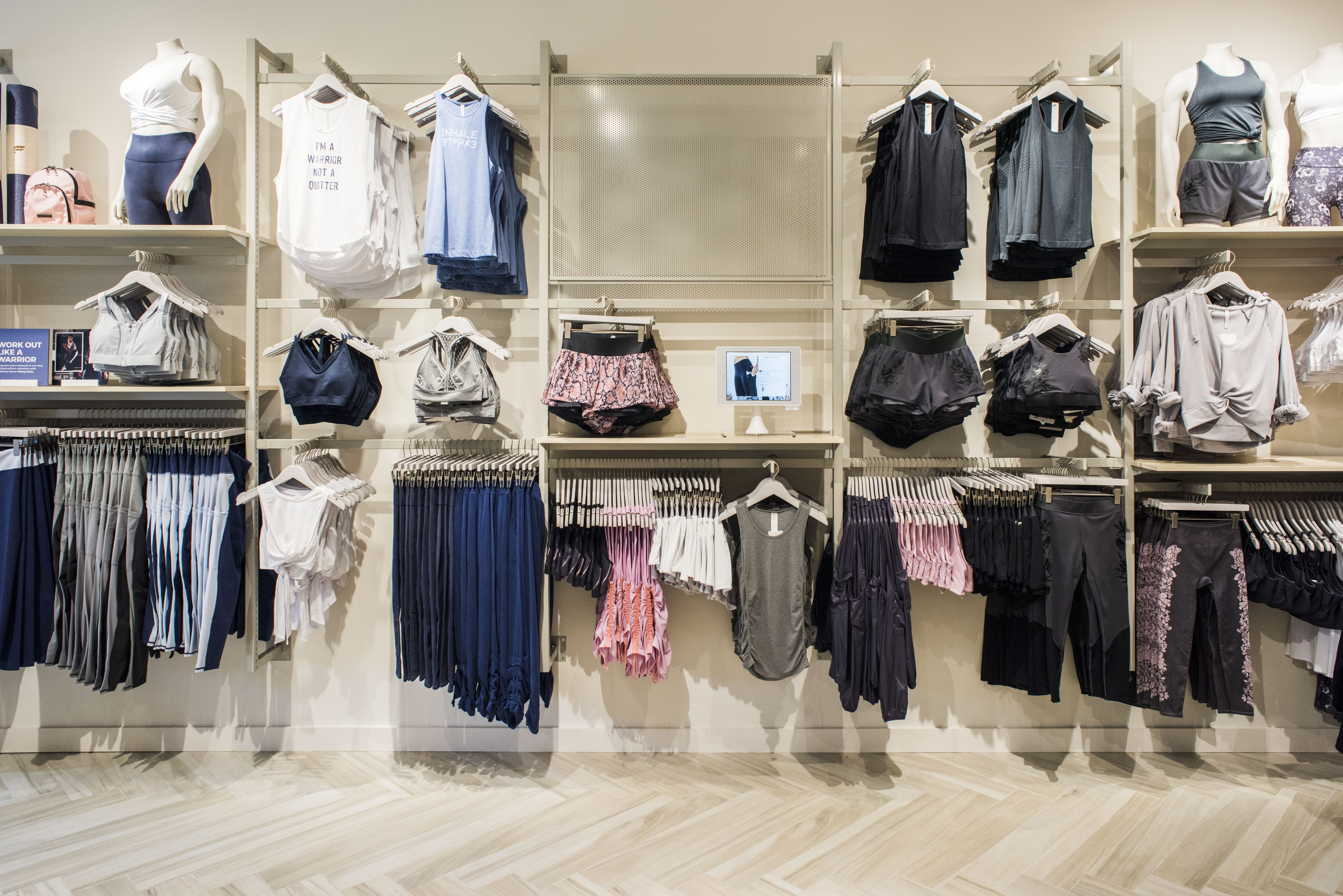 fabletics in-aisle kiosks for membership sign up and price checking